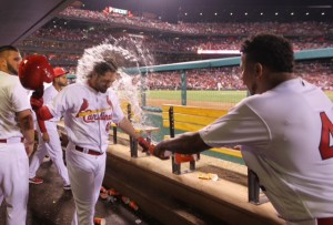 St. Louis Cardinals pitcher Carlos Martinez wets down Randal Grichuk after he hit a solo home run in the seventh inning against the Cincinnati Reds at Busch Stadium in St. Louis on April 15, 2016.   Photo by Bill Greenbatt/UPI