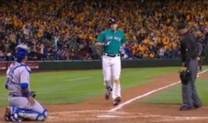 Seth Smith prepares to touch home plate after hitting his 100th career home run
