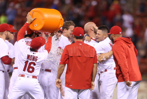 St. Louis Cardinals Matt Holliday is hugged by Yadier Molina, while Kolton Wong pours water on the group celebrating Holliday's walk off RBI single to defeat the Philadelphia Phillies 5-4, at Busch Stadium in St. Louis on May 4, 2016. St. Louis won the game 5-4.    Photo by Bill Greenblatt/UPI