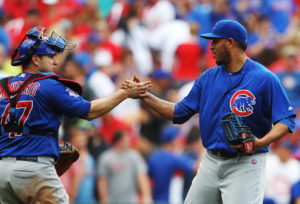 Chicago Cubs catcher Miguel Montero shakes the hand of pitcher Hector Rondon after the third out and a 9-8 win over the St. Louis Cardinals at Busch Stadium in St. Louis on May 25, 2016.  Photo by Bill Greenblatt/UPI