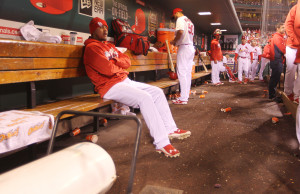 St. Louis Cardinals starting pitcher Carlos Martinez sits in dugout trying to stay warm near the heater during a game against the Philadelphia Phillies at Busch Stadium in St. Louis on May 2, 2016. It was released on 5/2/2016 that Martinez is accused of knowingly giving his partner STD's in $1.5million lawsuit.  Photo by Bill Greenblatt/UPI