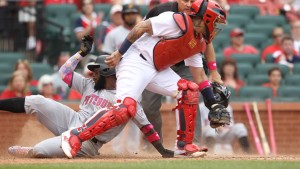 Pittsburgh Pirates Josh Harrison slides safely into home plate past St. Louis Cardinals catcher Yadier with the tenth run of the game in the ninth inning at Busch Stadium in St. Louis on May 7, 2016. Pittsburgh defeated St. Louis 10-5.    Photo by Bill Greenblatt/UPI