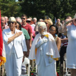 Members of the Amercian Gold Star Mothers, pause as an American flag passes during the beginning of a Memorial Day Service at Jefferson Barracks National Cemetery in St. Louis on May 30, 2016. Photo by Bill Greenblatt/UPI