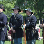 Members of a Civil War reenactment group watch a Memorial Day Service at Jefferson Barracks National Cemetery in St. Louis on May 30, 2016. Photo by Bill Greenblatt/UPI