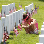 A visitor to Jefferson Barracks National Cemetery pauses in front of a grave site for a loved one on Memorial Day in St. Louis on May 30, 2016. Photo by Bill Greenblatt/UPI