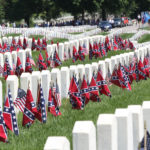 Confederate flags line grave sites in the Confederate section of Jefferson Barracks National Cemetery on Memorial Day in St. Louis on May 30, 2016. Photo by Bill Greenblatt/UPI
