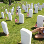 Tammy Elkins of Fenton, Missouri spends time next to her fathers grave site on Memorial Day at Jefferson Barracks National Cemetery in St. Louis on May 30, 2016. Photo by Bill Greenblatt/UPI