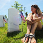 Tammy Elkins of Fenton, Missouri spends her first Memorial Day at her fathers grave site at Jefferson Barracks National Cemetery in St. Louis on May 30, 2016. Photo by Bill Greenblatt/UPI