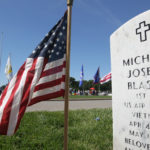 A Memorial Day service is underway at Jefferson Barracks National Cemetery near the grave site of Lt. Michael Blassie in St. Louis on May 30, 2016.  Blassie died when his A-37B Dragonfly was shot down near An Lộc in what was then South Vietnam in 1972. Blassie's remains were designated as the unknown service member from the Vietnam War, A CBS News report in January 1998 claimed the Vietnam unknown was Blassie based on mitochondrial DNA testing. On July 10, 1998 Blassie's remains were transported to his family in St.Louis.  Photo by Bill Greenblatt/UPI