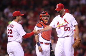 St. Louis Cardinals starting pitcher Adam Wainwright hands the baseball to manager Mike Matheny as he leaves the game in the seventh inning against the Colorado Rockies at Busch Stadium in St. Louis on May 18, 2016. St. Louis won the game 2-0. Photo by Bill Greenblatt/UPI