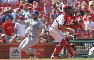 Texas Rangers Mitch Moreland scores around St. Louis Cardinals catcher Eric Fryer for the go ahead run in the eighth inning at Busch Stadium in St. Louis on June 19, 2016. Texas won the game 5-4.   Photo by Bill Greenblatt/UPI