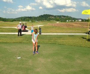 A family enjoys a round of golf at the Ken Lanning Golf Center in Jefferson City