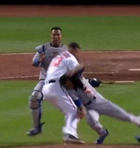 Manny Machado lands a punch after getting plunked by Yordano Ventura