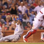 Cardinals rally to tie twice, but Royals finally put the game away in the 12th