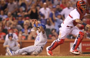 Kansas City Royals Christian Colon slides safely with the Royals first run of the game past St. Louis Cardinals catcher Yadier Molina in the eighth inning at Busch Stadium in St. Louis on June 29, 2016. Photo by Bill Greenblatt/UPI