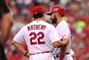 St. Louis Cardinals manager Mike Matheny talks to Matt Carpenter after swinging at a pitch and injuring his sdie in the third inning against the Pittsburgh Pirates at Busch Stadium in St. Louis on July 6, 2016. Carpenter left the game with an apparent injury. Photo by Bill Greenblatt/UPI