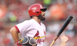St. Louis Cardinals Matt Carpenter grimaces as he grabs his side after swinging in the third inning against the Pittsburgh Pirates at Busch Stadium in St. Louis on July 6, 2016. Carpenter left the gqame with an apparent injury. Photo by Bill Greenblatt/UPI