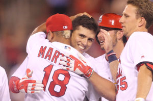 St. Louis Cardinals Aledmys Diaz is congratulated by teammates after hitting the winning single against the San Diego Padres in the ninth inning at Busch Stadium in St. Louis on July 21, 2016. St. Louis won the game 6-5.     Photo by Bill Greenblatt/UPI