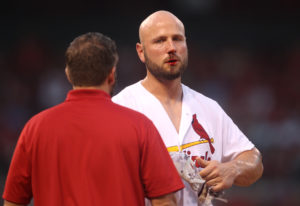 St. Louis Cardinals Matt Holliday leaves the game with head trainer Adam Olsen, after getting hit in the nose by San Diego Padres Andrew Cashner pitch in the sixth inning at Busch Stadium in St. Louis on July 22, 2016.    Photo by Bill Greenblatt/UPI