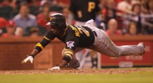 Andrew McCutcheon dives into home scoring a run for the Pirates. (photo/Bill Greenblatt, UPI)