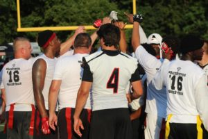 The White jersey team celebrates their win in the first Cops and Hawks Bowl--photo-SEMO Athletics