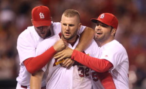 St. Louis Cardinals Matt Adams is mobbed by teammates after hitting a walk off home run to defeat the Los Angeles Dodgers 4-3 in 16 innings at Busch Stadium in St. Louis on July 22, 2016.    Photo by Bill Greenblatt/UPI