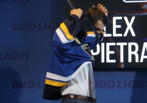 St. Louis Blues Alex Pietrangelo slips into his new sweater after he was named the 21st team captain of the St. Louis Blues at the Scottrade Center in St. Louis on August 25, 2016.   Photo by Bill Greenblatt/UPI