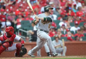 Oakland Athletics Stephen Vogt swings hitting a three run home run in the third inning against the St. Louis Cardinals at Busch Stadium in St. Louis on August 28, 2016. Oakland won the game 7-4.    Photo by Bill Greenblatt/UPI