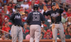 Atlanta Braves Nick Markakis (L) and Freddie Freeman wait for Adonis Garcia after Garcia hit a three run home run in the fifth inning against the St. Louis Cardinals at Busch Stadium in St. Louis on August 6, 2016.The three run home run is the second for the Braves on the night.       Photo by Bill Greenblatt/UPI