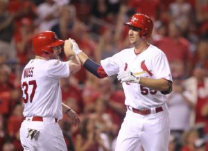 St. Louis Cardinals Stephen Piscotty is welcomed at home plate by Brandon Moss after hitting a two run home run in the fifth inning against the New York Mets at Busch Stadium in St. Louis on August 24, 2016.    Photo by Bill Greenblatt/UPI