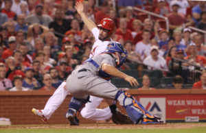 St. Louis Cardinals Randal Grichuk is tagged out at homeplate by New York Mets catcher Travis D'Arnaud in the second inning at Busch Stadium in St. Louis on August 24, 2016. Photo by Bill Greenblatt/UPI