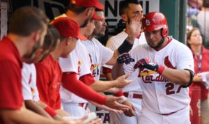 St. Louis Cardinals Jhonny Peralta is congratulated by teammates after hitting a solo home run in the fourth inning against the Cincinnati Reds at Busch Stadium in St. Louis on August 10, 2016.   Photo by Bill Greenblatt/UPI
