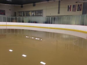 Water was as high as the top of the hockey boards early Monday morning (photo/Bill Pollock)