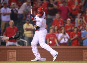 St. Louis Cardinals Yadier Molina gets hit by a pitch with bases loaded against the Cincinnati Reds in the ninth inning at Busch Stadium in St. Louis on August 8, 2016. St. Louis won the game 5-4. Photo by Bill Greenblatt/UPI