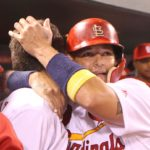 St. Louis Cardinals Aledmys Diaz gets an emotional hug from Yadier Molina after hitting a grand slam home run in the fourth inning against the Cincinnati Reds at Busch Stadium in St. Louis on September 27, 2016. Photo by Bill Greenblatt/UPI
