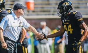 Emanuel Hall (84) is greeted by Barry Odom after his second quarter touchdown (photo/Mizzou Athletics)