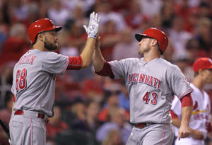 Cincinnati Reds Scott Schebler (R) is congratulated by Tim Adleman as he crosses home plate in the fourth inning against the St. Louis Cardinals at Busch Stadium in St. Louis on September 26, 2016. Cincinnati scored seven times in the inning.   Photo by Bill Greenblatt/UPI
