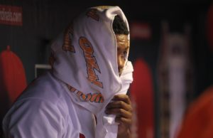 St. Louis Cardinals pitcher Alex Reyes watches the third inning against the Chicago Cubs from underneath a towel in the dugout at Busch STadium in St. Louis on September 13, 2016    Photo by Bill Greenblatt/UPI