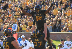 Missouri Tigers Damarea Crockett is lifted by teammate Paul Adams after scoring a touchdown in the second quarter against the Middle Tennessee Blue Raiders at Faurot Field in Columbia, Missouri on October 22, 2016. Middle Tennessee defeated Missouri 51-45. Photo by Bill Greenblatt/UPI