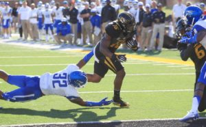 Missouri Tigers Damarea Crockett eludes Middle Tennessee Blue Raiders Chris Melton for a touchdown in the second quarter at Faurot Field in Columbia, Missouri on October 22, 2016.  Photo by Bill Greenblatt/UPI