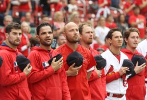 St. Louis Cardinals Matt Holliday (C) stands with teammates for the National Anthem before a game against the Pittsburgh Pirates at Busch Stadium in St. Louis on October 2, 2016.Photo by Bill Greenblatt/UPI