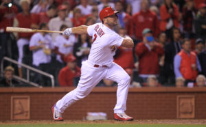 St. Louis Cardinals Matt Holliday swings hitting a solo home run in the seventh inning against the Pittsburgh Pirates at Busch Stadium in St. Louis on September 30, 2016. Photo by Bill Greenblatt/UPI