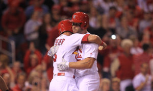 St. Louis Cardinals Matt Holliday (R) is greeted by Matt Carpenter after Holliday hit a solo home run in the seventh inning against the Pittsburgh Pirates at Busch Stadium in St. Louis on September 30, 2016. The home run is Hollidays first pinch hit home run of his career. Photo by Bill Greenblatt/UPI