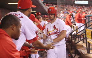 St. Louis Cardinals Matt Holliday is congratulated after hitting a solo home run in the seventh inning against the Pittsburgh Pirates at Busch Stadium in St. Louis on September 30, 2016. Photo by Bill Greenblatt/UPI