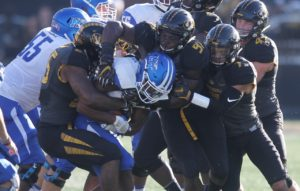 The Missouri Tigers defense swarm Middle Tennessee Blue Raiders L'Tvius Mathers for the tackle in the second quarter at Faurot Field in Columbia, Missouri on October 22, 2016. Photo by Bill Greenblatt/UPI