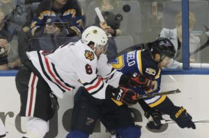 St. Louis Blues Alex Pietrangelo and Chicago Blackhawks Michal Kempny push off of each other as the puck flies betwen them in the first period at the Scottrade Center in St. Louis on November 9, 2016.    Photo by Bill Greenblatt/UPI