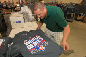 Owner Larry Hanneke inspects one of the nearly 40 thousand Chicago Cubs Championship tee shirts his company is making at Hannekes Logo Wear in St. Louis on November 3, 2016. The shirts are being shipped to stores in the Chicacgo area. The Chicago Cubs defeated the Cleveland Indians on November 2, 2016, to win the World Series. Photo by Bill Greenblatt/UPI