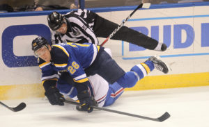 St. Louis Blues Paul Stastny levels Montreal Canadiens Torrey Mitchell, taking linesman Mark Wheler with them in the first period at the Scottrade Center in St. Louis on December 6, 2016. Photo by Bill Greenblatt/UPI