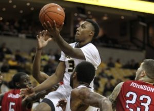 Frankie Hughes drives for a layup against Western Kentucky (photo/Mizzou Athletics)