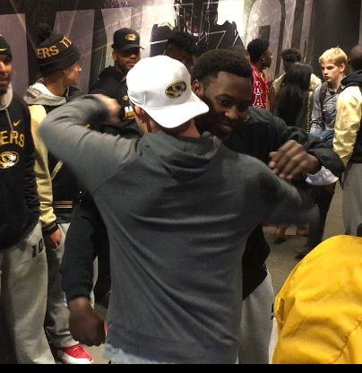 Charles Harris gets a hug from teammate Michael Scherer following his announcement that he will enter the NFL Draft